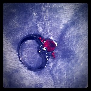 Black silver ring size 7 with ruby stone.